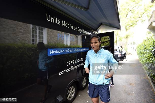 France's defender Wendie Renard leaves a medical device used for cryotherapy at at the French national football team training base in...