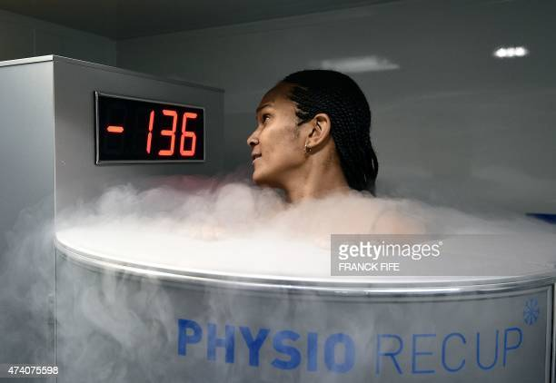 France's defender Wendie Renard reacts as she undergoes treatment in a medical device used for cryotherapy at the French national football team...