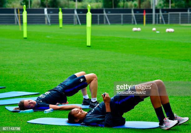 France's defender Wendie Renard stretches during a training during the UEFA Women's Euro 2017 football tournament in Zwijndrecht on July 23 2017 /...
