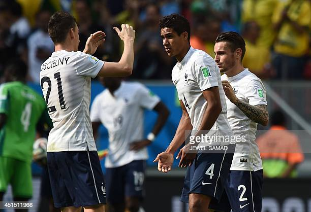 France's defenders Laurent Koscielny Raphael Varane and Mathieu Debuchy celebrate at the end of the round of 16 football match between France and...