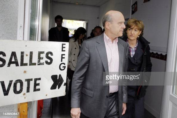 France's Defense minister Alain Juppe leaves with his wife Isabelle after their vote on May 6 2012 in a polling station in Bordeaux southwestern...