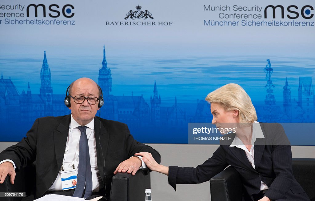 France's Defense Minister Jean-Yves Le Drian (L) and his German counterpart Ursula von der Leyen attend a panel discussion at the 52nd Munich Security Conference (MSC) in Munich, southern Germany, on February 12, 2016. / AFP / THOMAS KIENZLE