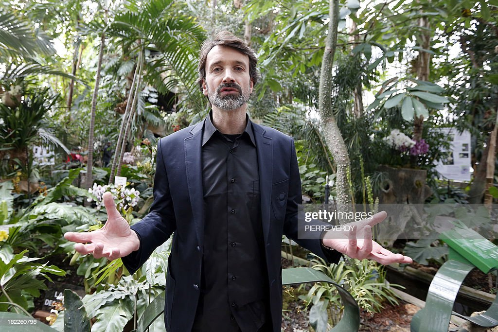 France's Denis Larpin, botanist of the 'Mille et une orchidees' (1,001 orchids) exhibition organized at the Jardin des Plantes in Paris, poses on February 21, 2013 in front of flowers that are part of the Jardin du Luxembourg collection. The event runs from February 22 to March 23, 2013.