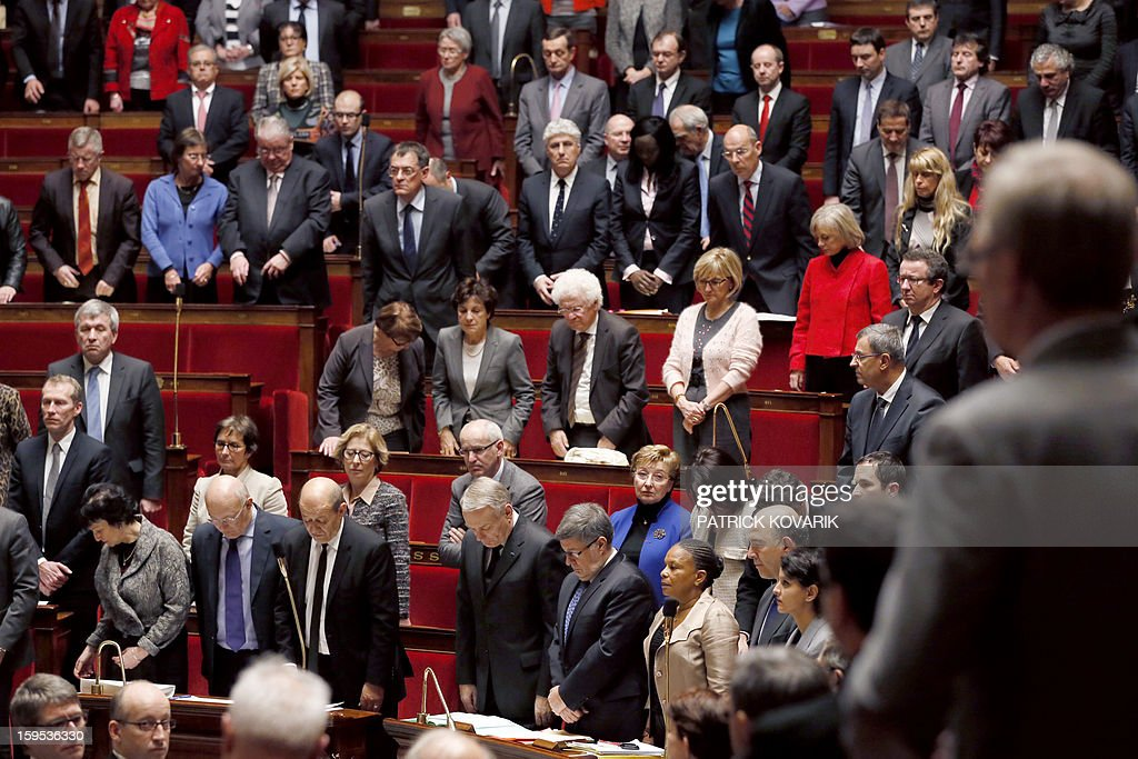 France's deputies and government members observe a minute of silence in memory of French air force lieutenant Damien Boiteux, who died on January 11 during a helicopter raid launched to support Mali ground troops in the battle for the key town of Kona, during a session of questions to the government on January 15, 2013 at the French National Assembly in Paris. AFP PHOTO / PATRICK KOVARIK