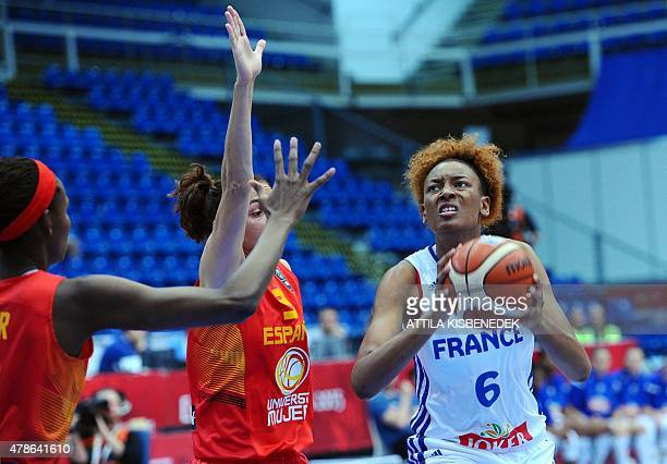 France's Diandra Tchatchouang vies for the ball with Spain's Astou Ndour and Laia Palau during a semi final basketball match between France and Spain...
