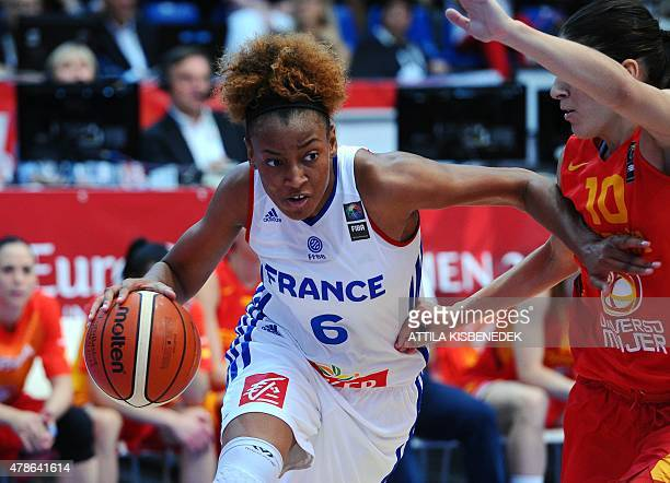 France's Diandra Tchatchouang vies for the ball with Spain's Marta Xargay during a semi final basketball match between France and Spain of the...
