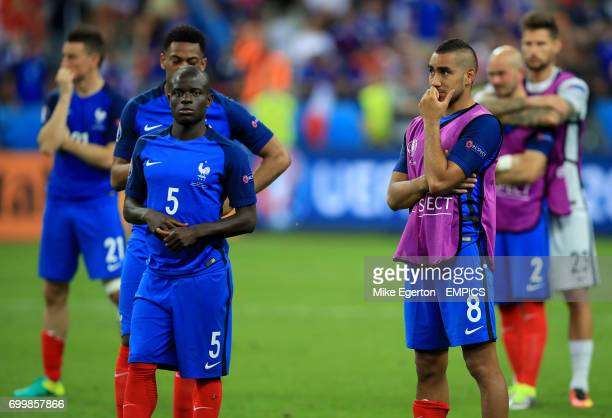 France's Dimitri Payet and N'Golo Kante look dejected after the game