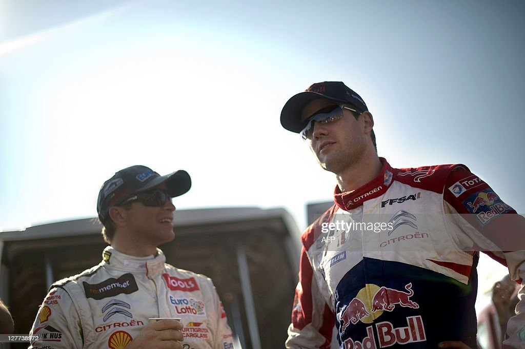 France's driver Sebastien Ogier (R) talks with Norway's driver Petter Solberg on October 1, 2011 in Colmar eastern France, during the second stage of France's Rallye Alsace which will run until October 02, 2011.