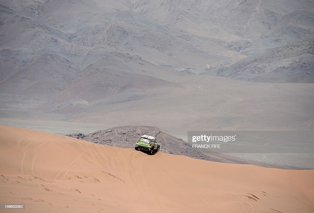 France's driver Stephane Perterhansel steers his Mini during the Stage 12 of the 2013 Dakar Rally between Fiambala in Argentina and Copiapo in Chile, on January 17, 2013. The rally is taking place in Peru, Argentina and Chile from January 5 to 20.