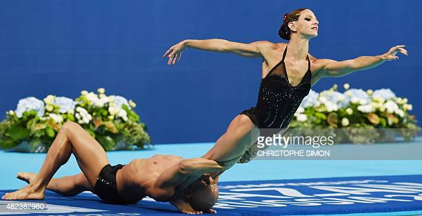 France's duet Benoit Beaufils and Virginie Dedieu competes in the Mixed duet Free final event during the synchronised swimming competition at the...