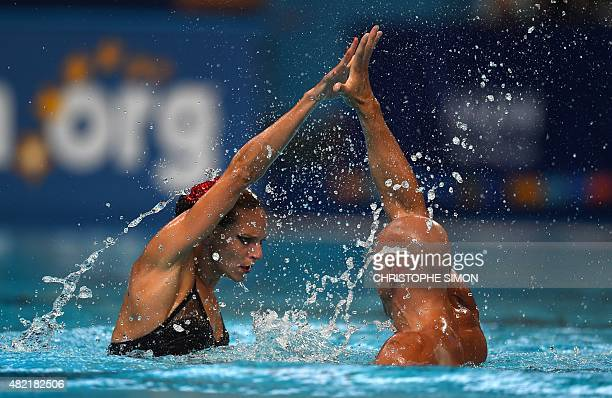 France's duet Virginie Dedieu and Benoit Beaufils competes in the Mixed duet Free preliminary event during the synchronised swimming competition at...