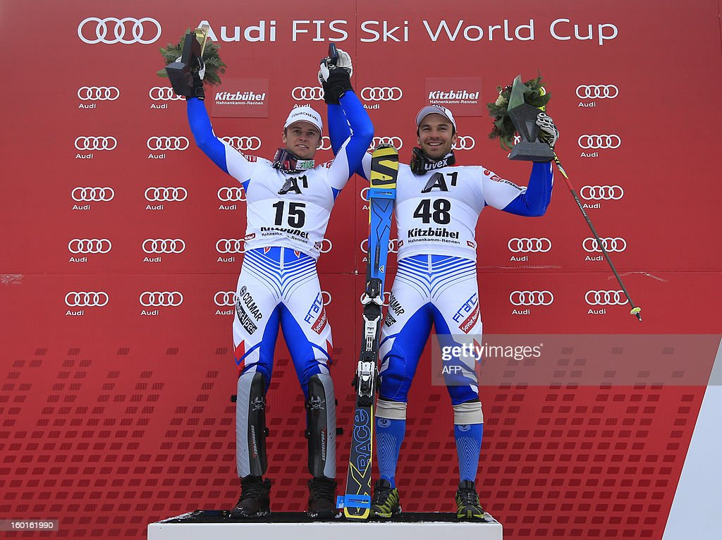 France's duo Alexis Pinturault (L) and Thomas Blondin Mermillod (R) celebrate their second and third position on the podium of the FIS World Cup men's super combined on January 27, 2013 in Kitzbuehel, Austrian Alps. Croatia's Ivica Kostelic won the combined title ahead of French duo Alexis Pinturault and Thomas Mermillod Blondin .
