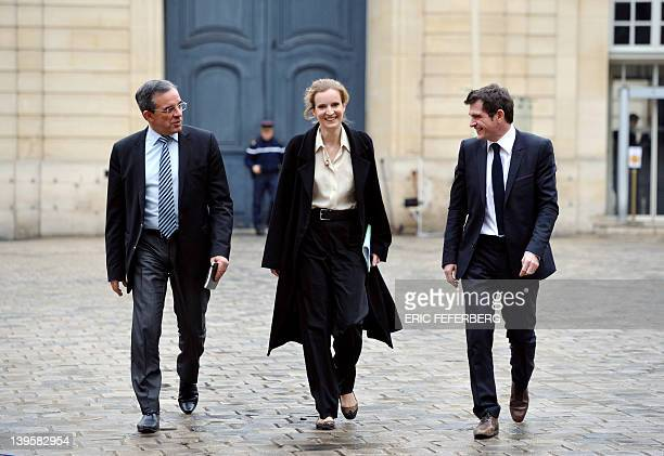 France's Ecology and Sustainable Minister Nathalie KosciuskoMorizet flanked by Housing Junior Minister Benoist Apparu and Transport Minister Thierry...