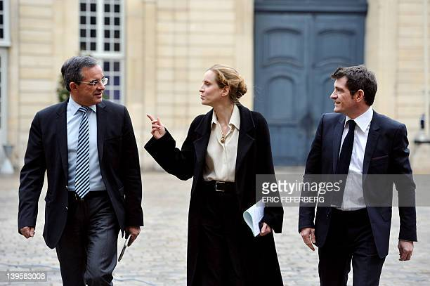 France's Ecology and Sustainable Minister Nathalie KosciuskoMorizet looks at Transport Minister Thierry Mariani flanked by Housing Junior Minister...