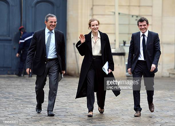 France's Ecology and Sustainable Minister Nathalie KosciuskoMorizet waves flanked by Housing Junior Minister Benoist Apparu and Transport Minister...