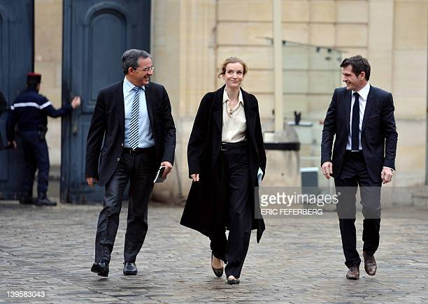 France's Ecology and Sustainable Minister Nathalie KosciuskoMorizet reacts flanked by Housing Junior Minister Benoist Apparu and Transport Minister...