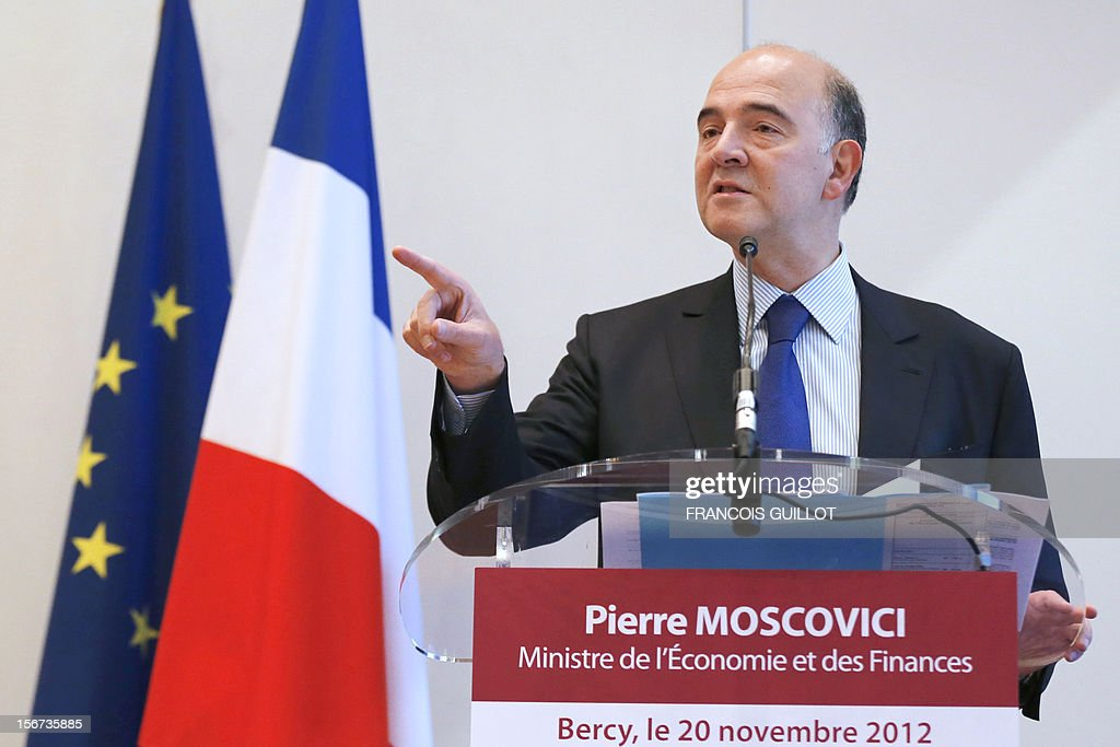 France's Economy minister Pierre Moscovici gives a press conference, on November 20, 2012 at the ministry in Paris, one day after the international ratings agency Moody's cut the French government bond rating by one notch from the highest level to 'Aa1' and warned that an additional downgrade was possible.
