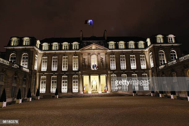 France's Elysee presidential palace is seen at 830 pm on March 27 in Paris before the lights are switched off for the Earth Hour campaign which comes...