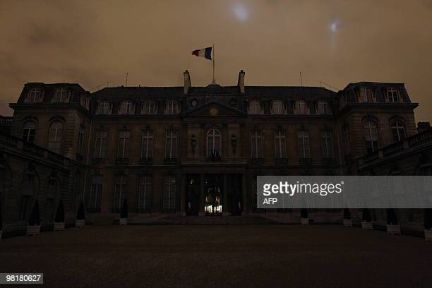 France's Elysee presidential palace is seen into darkness at 830 pm on March 27 in Paris as part of the Earth Hour switchoff which comes just months...