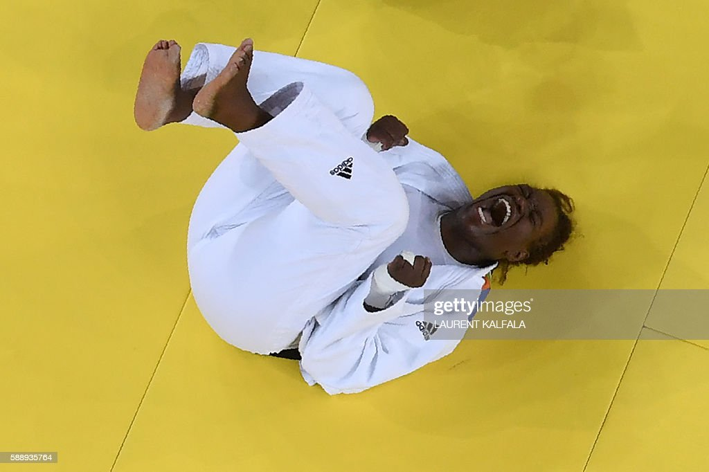 TOPSHOT France's Emilie Andeol celebrates after defeating Cuba's Idalys Ortiz during their women's 78kg judo contest gold medal match of the Rio 2016...