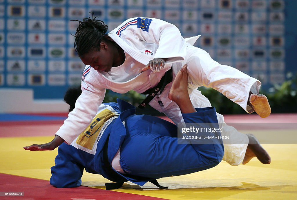France's Emilie Andeol (white) fights against Cuba's Heidy Abreu (blue) on February 10, 2013 in Paris, during the eliminatories of the Women + 78kg of the Paris Judo Grand Slam tournament.
