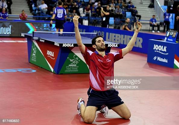 TOPSHOT France's Emmanuel Lebesson celebrates his victory over France's Simon Gauzy in 'Tuskecsarnok' sports hall of Budapest on October 23 2016...