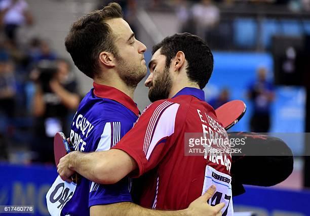 France's Emmanuel Lebesson celebrates his victory over France's Simon Gauzy in 'Tuskecsarnok' sports hall of Budapest on October 23 2016 during the...