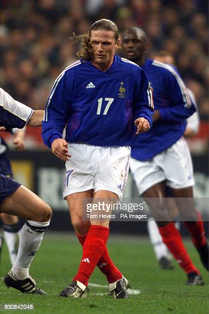 France's Emmanuel Petit in action during the international friendly match between France and Scotland at the Stade De France 08/09/03 who has quit...