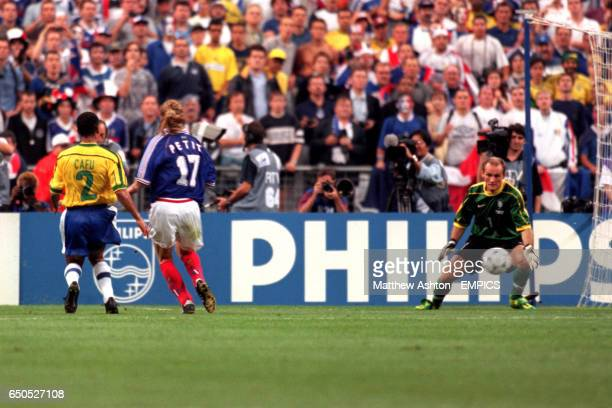 France's Emmanuel Petit scores the third goal past Brazil goalkeeper Taffarel as Brazil's Cafu looks on