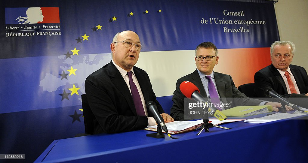 France's Employment Minister Michel Sapin, Luxembourg's Minister of Labour, Immigration and Employment Nicolas Schmit and Austria's Minister for Labour, Social Affairs and Consumer Protection Rudolf Hundstorfer give a press conference after a Council meeting at EU headquarters at EU headquarters in Brussels on February 28, 2013.