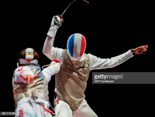France's Enzo Lefort and Denmark's Alexander Tsoronis fight during a qualification duel of the Individual Men's Foil competition at the World Fencing...