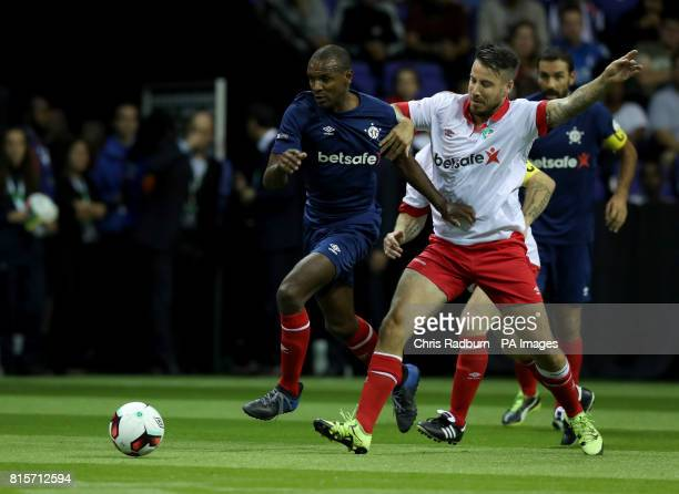 France's Eric Abidal is challenged by Denmark's Mikkel Beckmann during the final of the Star Sixes Tournament at The O2 Arena London PRESS...