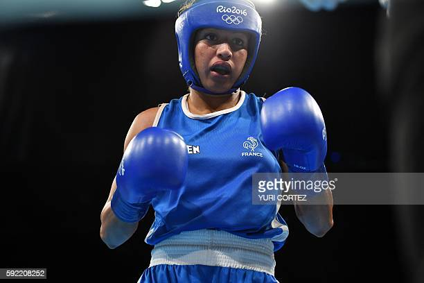 France's Estelle Mossely fights China's Yin Junhua during the Women's Light Final Bout at the Rio 2016 Olympic Games at the Riocentro Pavilion 6 in...