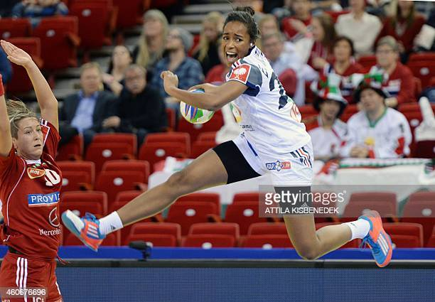 France's Estelle Nze Minko scores a goal in the Papp Laszlo Arena of Budapest on December 19 2014 during their 5th place match of Women's European...
