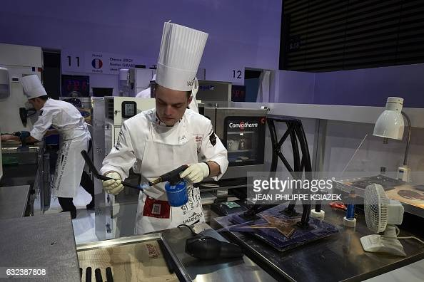 France's Etienne Leroy competes during the Pastries World Cup final on January 22 2017 in Chassieu outside Lyon as part of the Catering and Food...