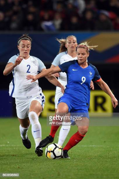 France's Eugenie Le Sommer vies with England's Lucy Bronze during the friendly football match between France and England at the Hainaut Stadium in...