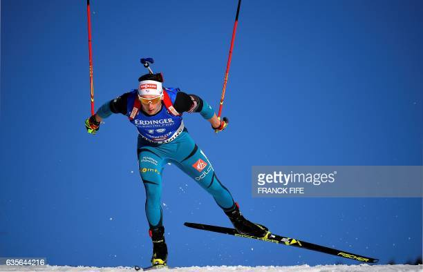 TOPSHOT France's Fabien Claude during the Men 20 km Individual event at the FIS Biathlon World Championships in Hochfilzen on February 16 2017 / AFP...
