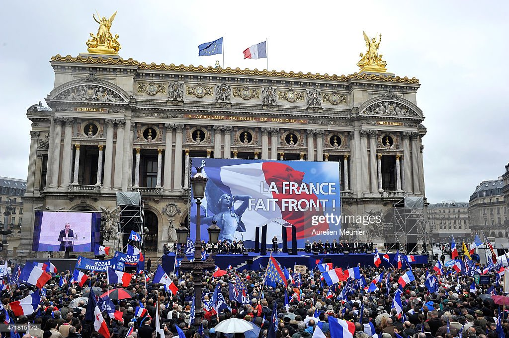France's farright Front National party president Marine Le Pen delivers a speech on stage during the National Front annual rally honoring Joan of Arc...