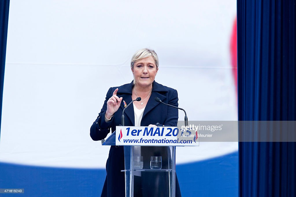 France's far-right Front National (FN) party president <a gi-track='captionPersonalityLinkClicked' href=/galleries/search?phrase=Marine+Le+Pen&family=editorial&specificpeople=588282 ng-click='$event.stopPropagation()'>Marine Le Pen</a> delivers a speech on stage during the National Front annual rally honoring Joan of Arc on Place de l'Opera, on May 1, 2015 in Paris, France. Annually over 1000 people from the FN Party demonstrate on May 1st.