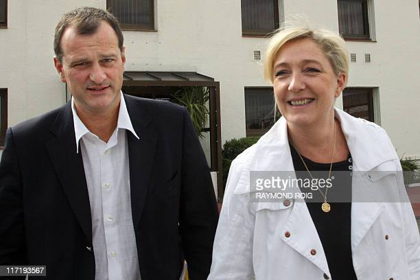 France's farright Front National party President Marine Le Pen flanked by Louis Aliot vicePresident of the party arrives to visit on June 11 2011 in...