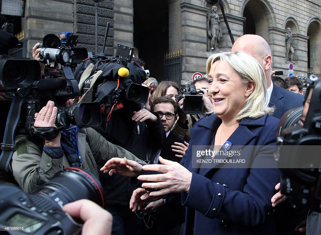 France's far-right National Front (FN) leader Marine Le Pen arrives to address supporters during a May Day rally in Paris on May 1, 2014. AFP PHOTO / KENZO TRIBOUILLARD