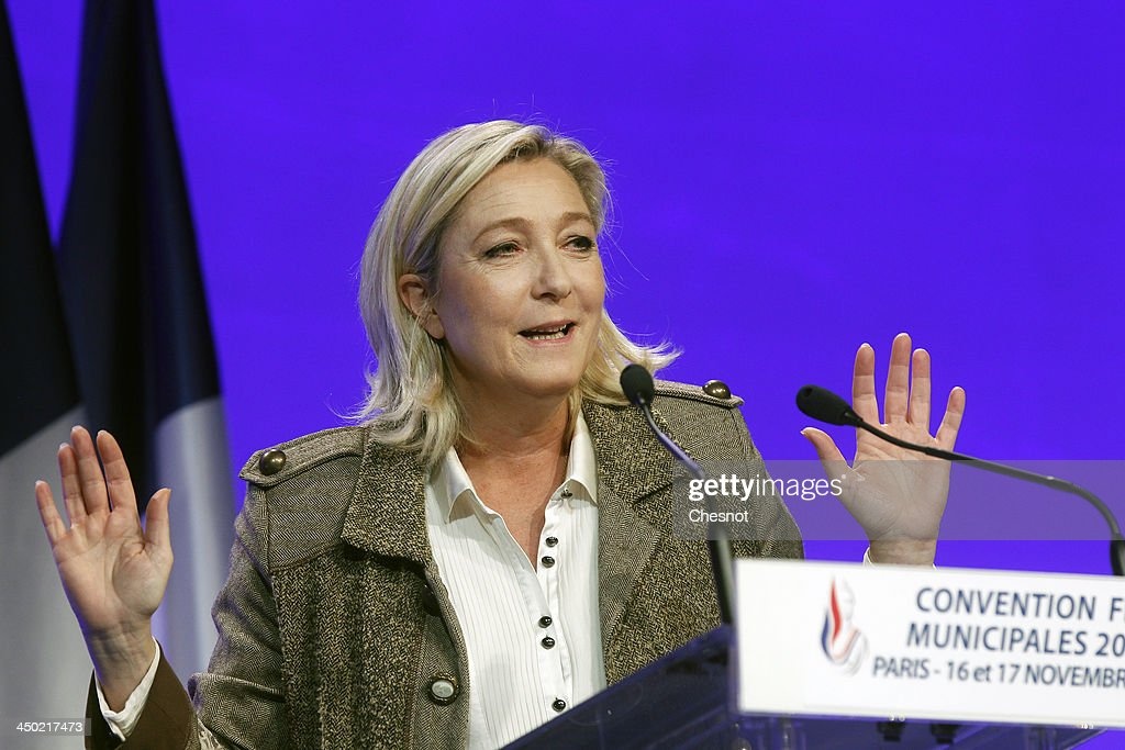 France's farright National Front leader Marine Le Pen delivers a speech during a party meeting on November 17 2013 in Paris France Le Pen called for...