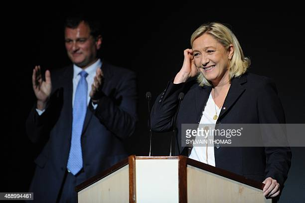 France's farright National Front leader Marine Le Pen gestures before delivering a speech during a meeting to support Louis Aliot Front National...