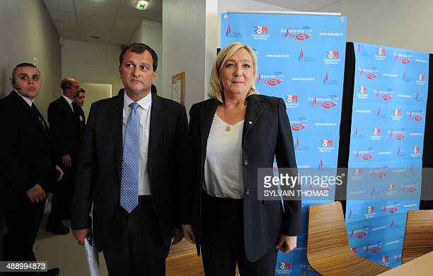 France's farright National Front leader Marine Le Pen pose during a press conference before a meeting to show support to Louis Aliot Front National...
