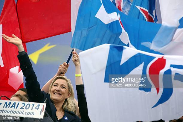France's farright National Front leader Marine Le Pen waves at supporters after delivering a speech at a May Day rally in Paris on May 1 2014 AFP...
