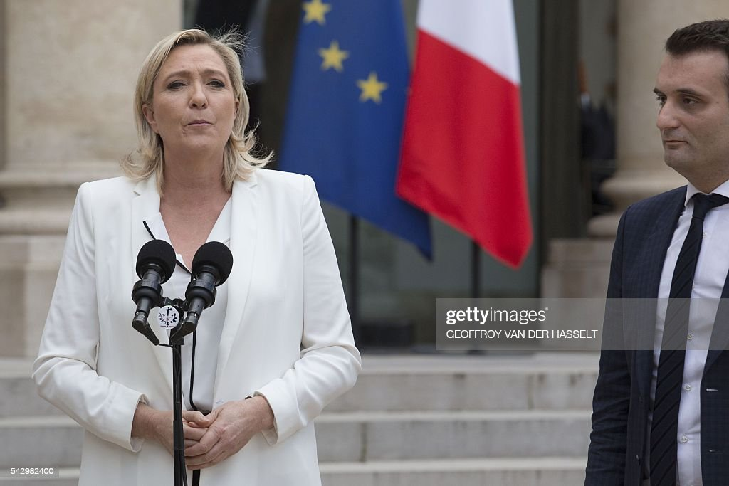 France's Far-right National Front (FN) party leader Marine Le Pen (L) makes a statement, next to FN vice-president Florian Philippot, following a meeting with French President on June 25, 2016 at the Elysee Palace in Paris, after Britain voted to leave the European Union a day before. Europe's press was awash with gloom and doom over Brexit on June 25, warning that it was a boon for nationalists while urging EU leaders to meet the challenge of their 'rendezvous with history'. / AFP / GEOFFROY
