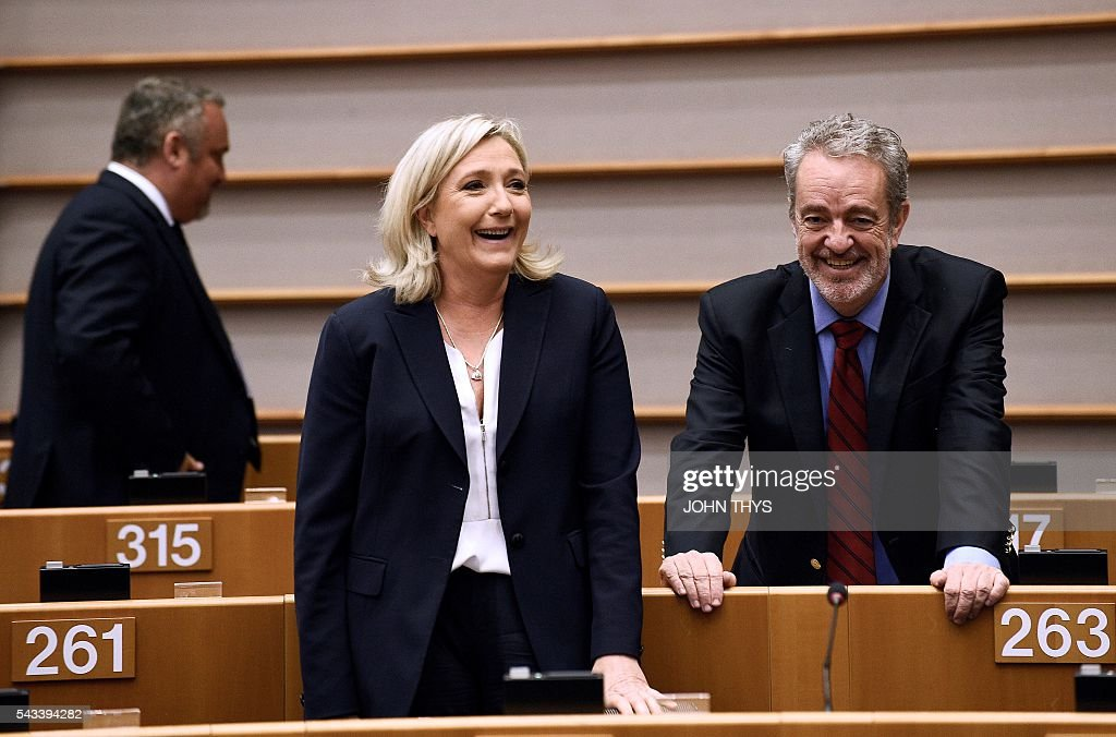 France's Far-right National Front (FN) party leader Marine Le Pen (L) talks with Gerolf Annemans from Flemish far-right political group Vlaams Belang (Flemish Interest) before a plenary session at the EU headquarters in Brussels on June 28, 2016. THYS