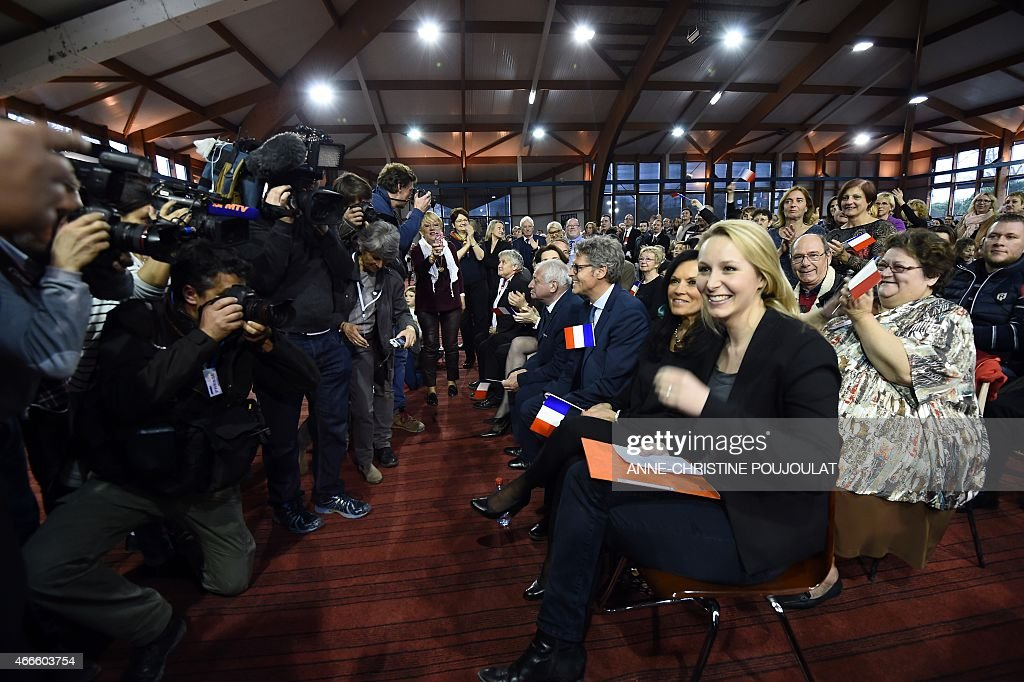 France's far-right National Front (FN) party MP Marion Marechal Le Pen smiles during a public meeting by the party's leader on March 17, 2015 in Le Pontet, southern France, ahead of the March 22 and 29 departemental local elections.