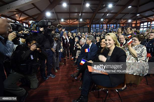 France's farright National Front party MP Marion Marechal Le Pen smiles during a public meeting by the party's leader on March 17 2015 in Le Pontet...