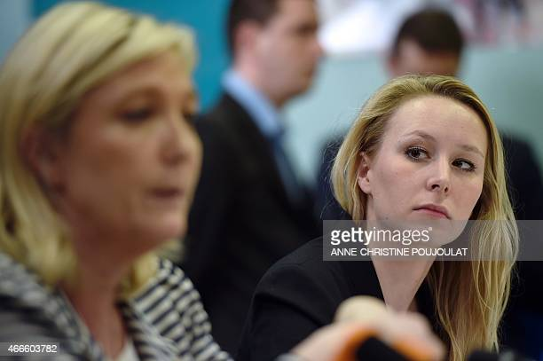 France's farright National Front party MP Marion Marechal Le Pen gives a press conference with the party's leader Marine Le Pen on March 17 2015 in...